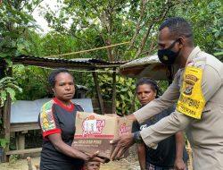 Kapolres Tolikara Serahkan Bantuan Pembangunan Rumah Kelompok Tani