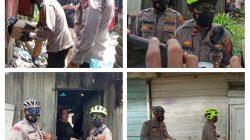 Kompol M Arifin SH Bagikan Sembako Kepada Warga Terdampak Covid Menggunakan Sepeda