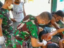 Satgas Yonif 512/QY Bantu Obati Masyarakat Yang Terluka.